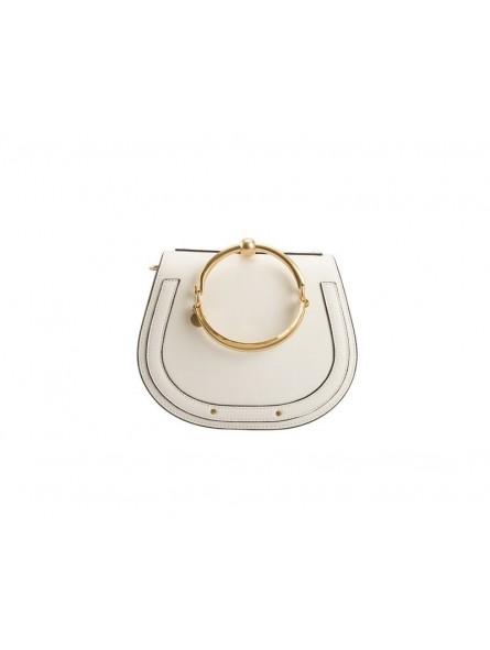 Leather bag with golden bracelet